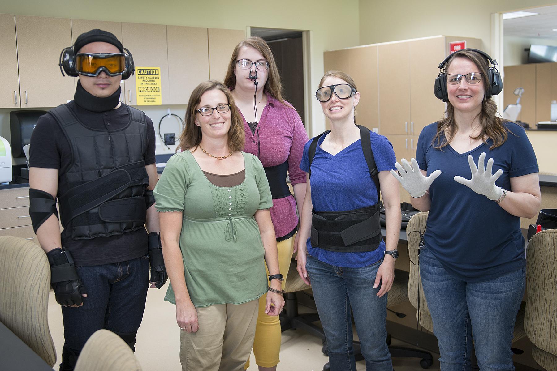 NTC Community members testing age simulation equipment