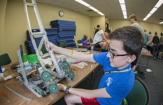 VEX Robotics camper working on robot