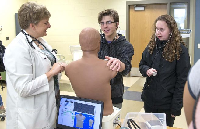 A student explores NTC's Nursing program at the college's March 21 Passport to the Future event.