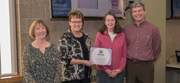 Pam Stowe (2nd from right) won NTC's Distinguished Service Award and was recognized for her upcoming retirement after 20 years of service. She's pictured with VP Karen Snorek (left), President Faith Hensrud and VP Darrin Strosahl.