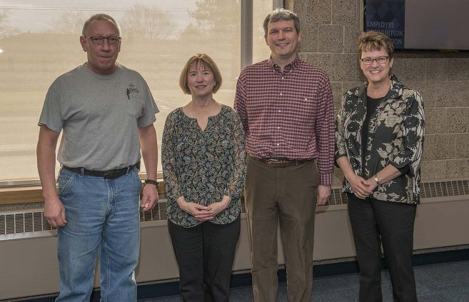 Charles Boyer (far left) was recognized for five years of service to NTC.