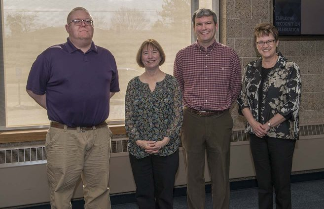 Scott Tadlock (far left) was recognized for five years of service to Distance Minnesota.