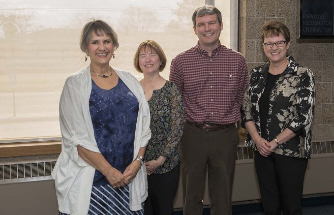 Sandy Johanning (far left) was recognized for 10 years of service to NTC.