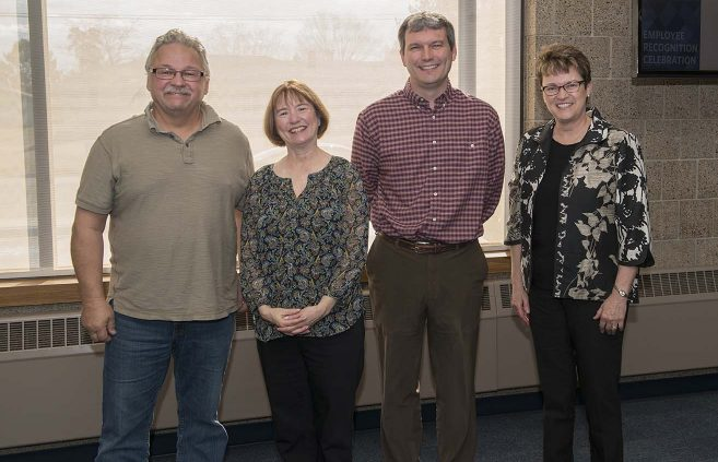 Jeff Brower (far left) was recognized for 25 years of service to NTC.