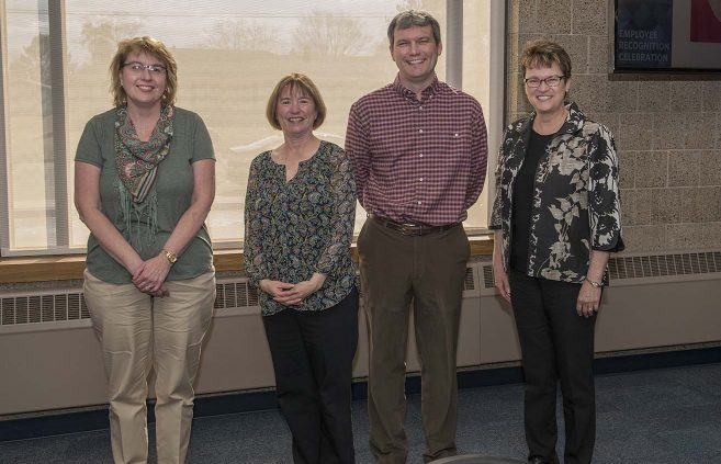 Judy Rinkenberger (far left) was recognized for 25 years of service to NTC.