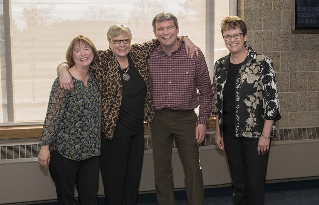 Sheila Lapp (2nd from left) was recognized for 25 years of service to NTC.