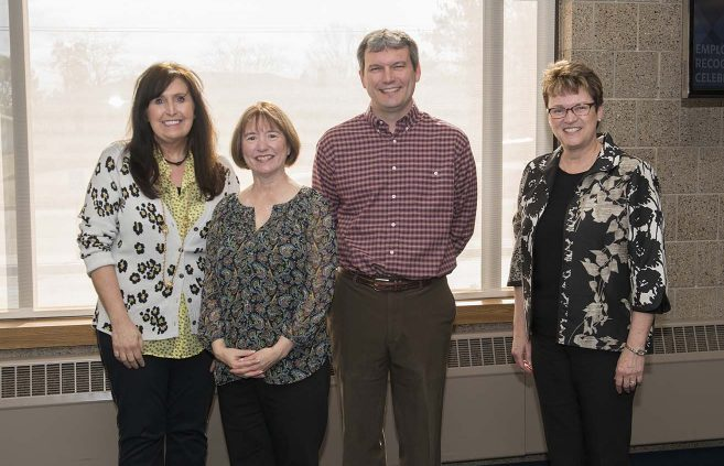 Carsha Lapp (far left) was recognized for 30 years of service to NTC.