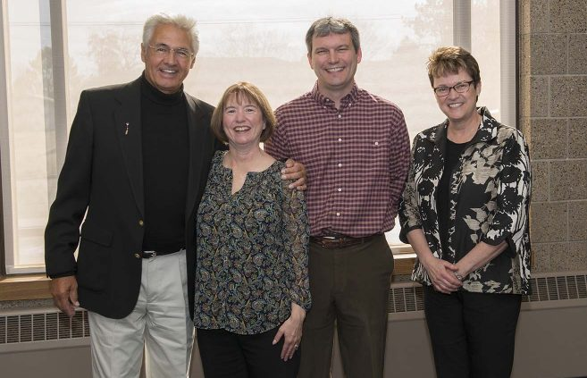 Joe Aitken (far left) accepted recognition on behalf of his wife, Margo Curb-Aitken, who is retiring from NTC after 16 years of service.