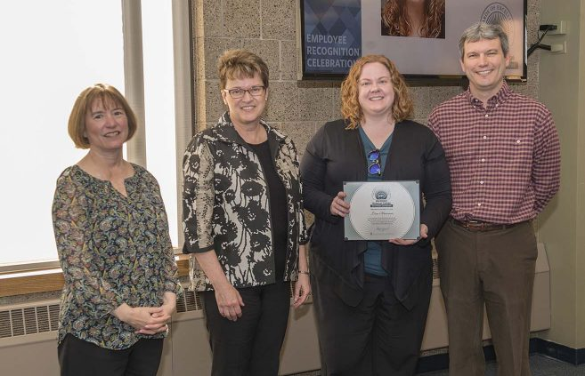 Lisa Hanson from the Office of Admissions (2nd from right) won NTC's Outstanding Contribution Award. She's pictured with VP Karen Snorek (left), President Faith Hensrud and VP Darrin Strosahl.