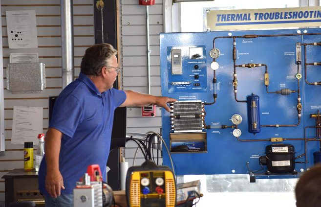 Jeff Brower, unlimited full-time faculty in plumbing, led an introduction to NTC's new Commercial Refrigeration/HVAC program to more than a half-dozen prospective students July 23 at the college's Sustainable Energy Technology Center.