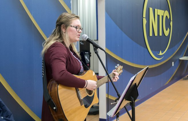 Sadie Fraley, a sophomore from Northome, Minn. opened the event by playing her guitar.