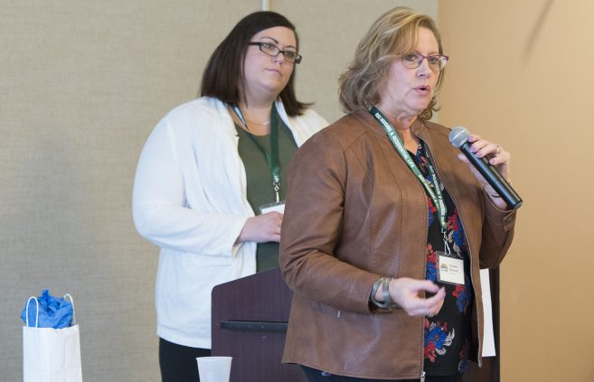 Connie Norman, CHW at Sanford Health, and Angie Keprios, patient support services at Northern Dental Access Center, presenting at the conference.