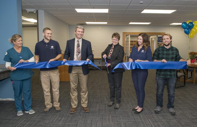President Hensrud officially opens the Student Success Center with a ribbon cutting.