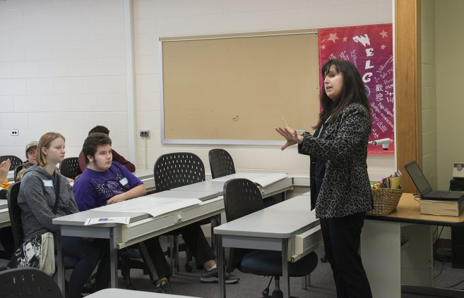 Carsha Lapp, sales and marketing faculty, speaking with the high school students.