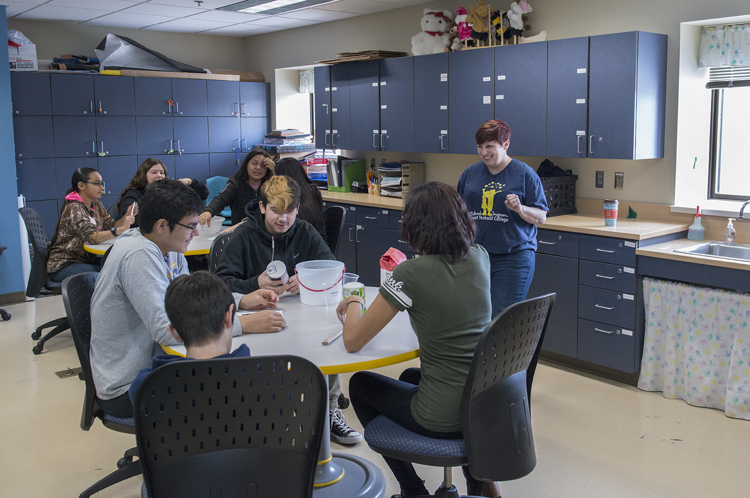 Heather Sutherland, early childhood education faculty, working with high school students.