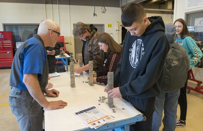 Ninth graders from Blackduck High School visiting NTC exploring automotive career pathways in the automotive lab.