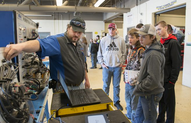 Ninth graders from Blackduck High School visiting NTC exploring career pathways with Automotive Services Technology Faculty Mark Johnson.