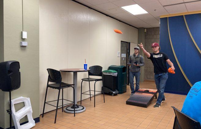 An impromptu cornhole tournament takes place among NTC students.
