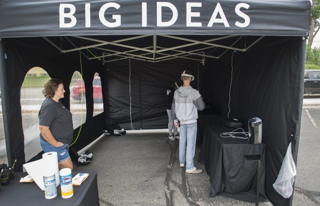 Attendees using equipment at the Big Ideas Road Show event.
